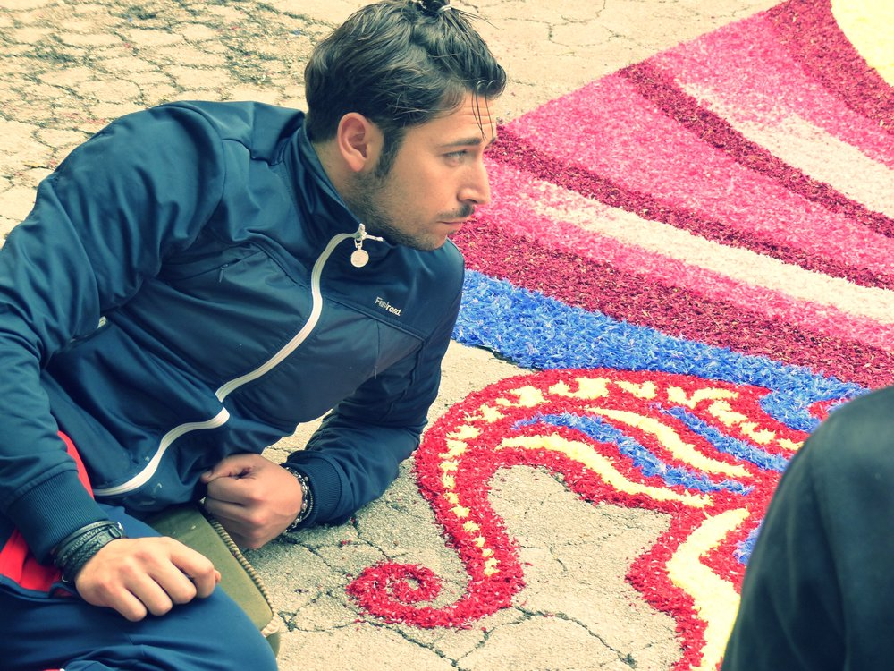 Laying flower carpet for Infiorata in Spello, Umbria