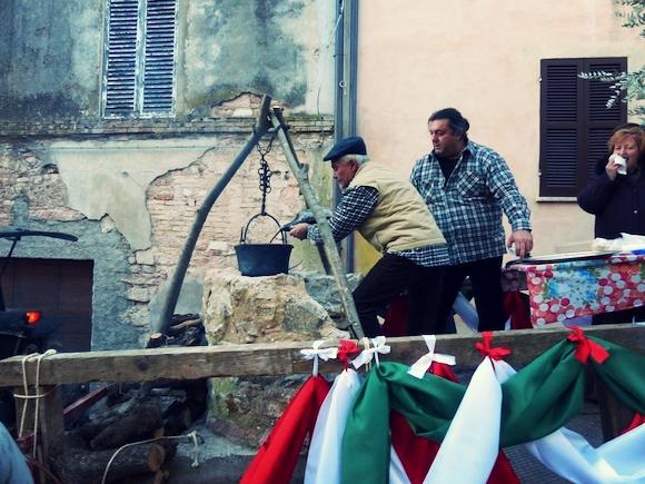 Serving wine at L'Oro di Spello, Umbria