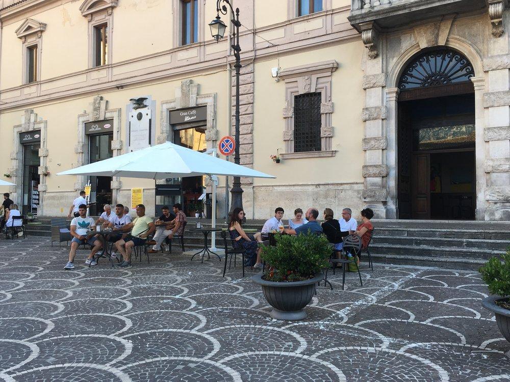 Enjoying aperitivo hour with Natalye, John, Claudia, and Julia in Sulmona, Abruzzo