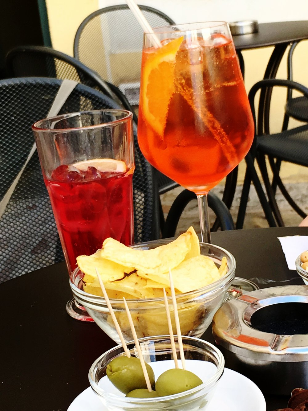 Aperol Spritz  - Pour prosecco and Aperol (3 to 1 proportions) into a glass of ice. Stir, add a splash of soda water if desired.Drop in a thin slice of orange.