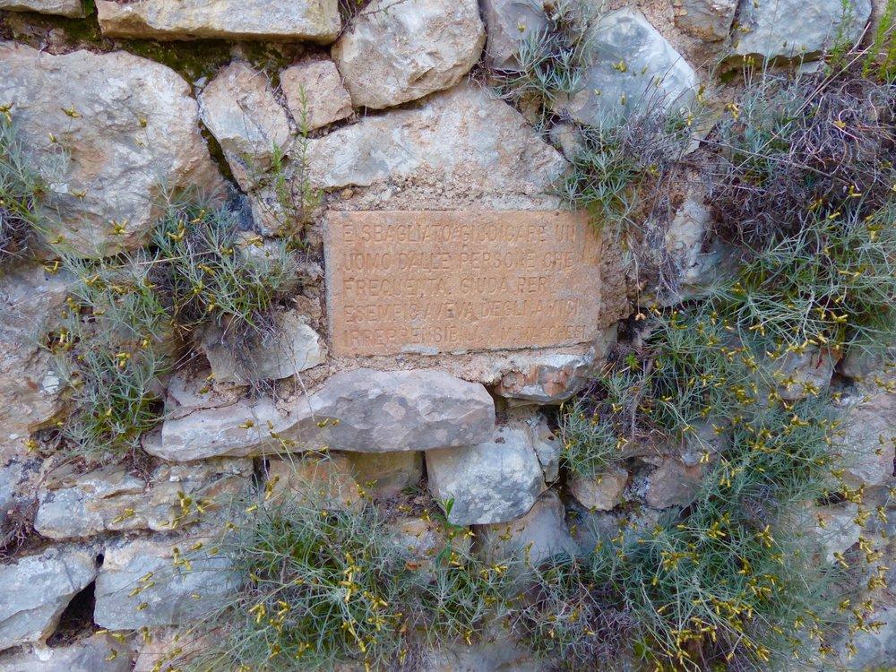 Quote along the aqueduct in Spello