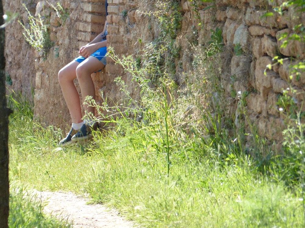 Gabe taking a break in the aqueduct in Spello