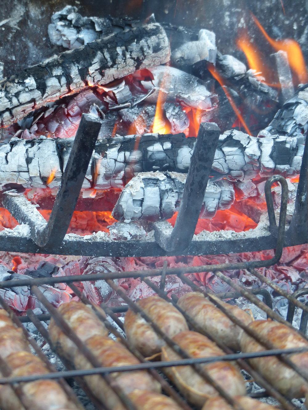 Grilling sausage in Spello, Umbria