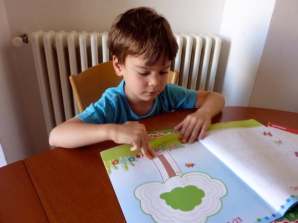 Gabe doing in homework in Spello