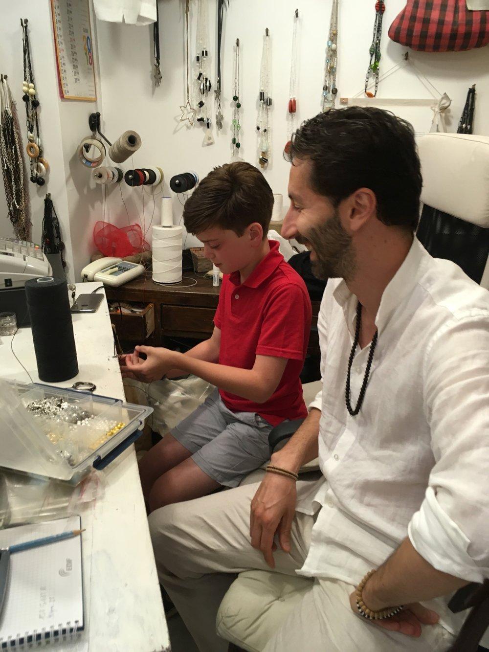 Gopala teaches Gabe to macrame in Spello, 2018