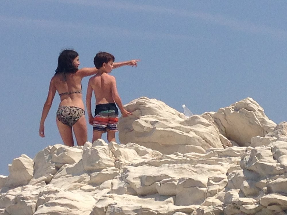 Kids play on the beach in Le Marche, Italy