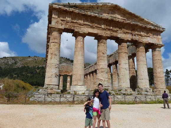 Kids pose in front of segesta in sicily, Italy