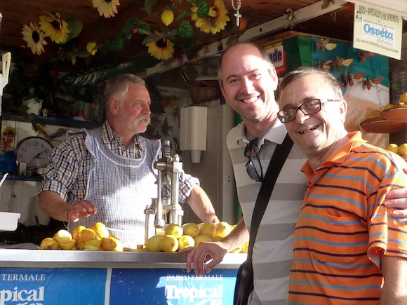 Keith and Giorgio getting juice from our new aproned friend in ischia