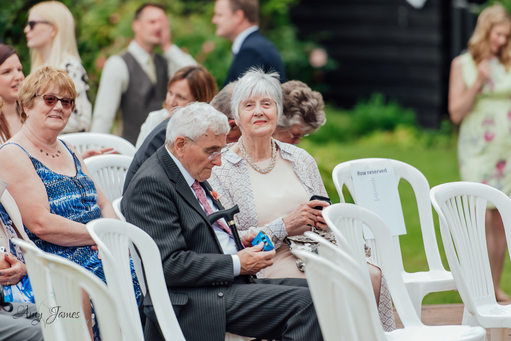 Wedding guests seated for an outdoor garden wedding ceremony - Amy James Photography - Taplins Place Wedding - Wedding Photographer Hampshire