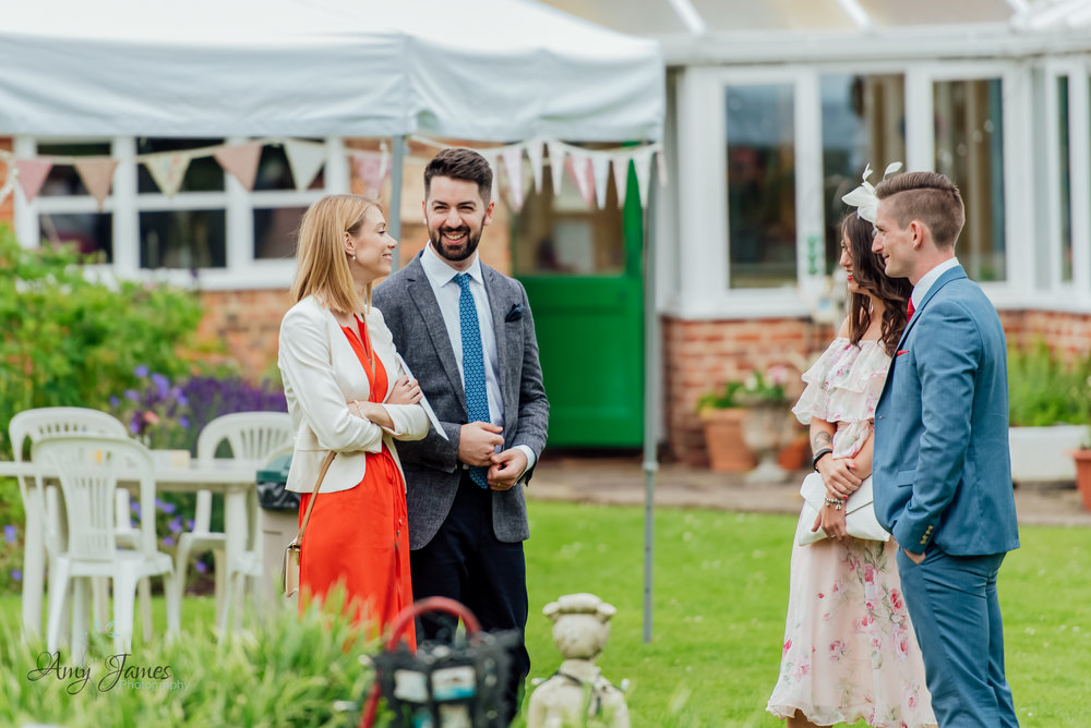 Guests at an outdoor garden wedding ceremony - Taplins Place - Wedding photographer Hampshire - Amy James Photography