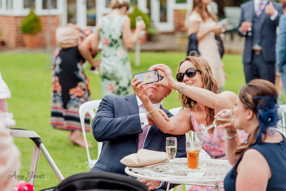 Outdoor garden wedding ceremony photograph by Amy James Photography Hampshire Wedding Photographer - Taplins Place Wedding selfie