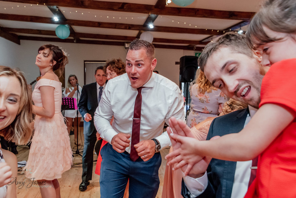 Dancefloor photo at Taplins Place Hampshire barn wedding venue by Amy James Photography documentary wedding photographer in Hampshire and Surrey