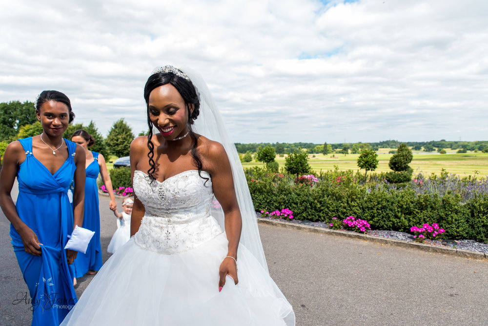 Bride arriving at Four Season Hotel Wedding by Amy James photography - documentary wedding photographer for Hampshire and Surrey