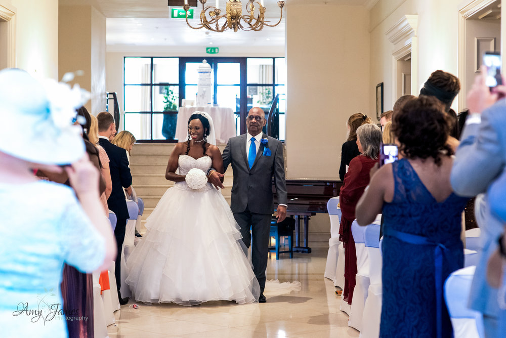 Bride walking down the aisle at Four Seasons Hotel Wedding Venue Hampshire - Amy James Photography documentary wedding photographer for Hampshire and Surrey