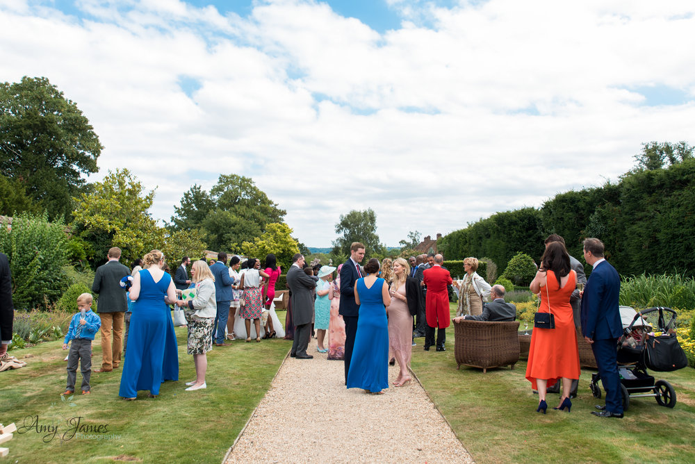 Drinks reception in walled garden at Four Seasons Hotel Hampshire - documentary wedding photography in Hampshire and Surrey - Amy James photography