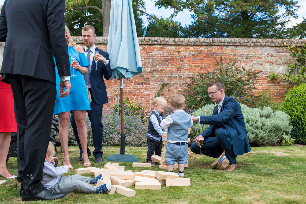 garden games at outside wedding venue Hampshire by Amy James photography documentary wedding photographer for Hampshire and surrey - four seasons hotel Hampshire