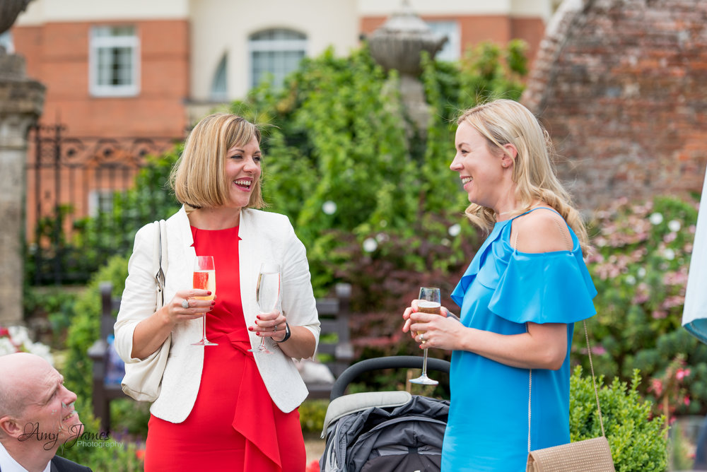 wedding drinks reception in walled garden at four seasons hotel Hampshire by Amy James photography wedding photographer Hampshire and Surrey
