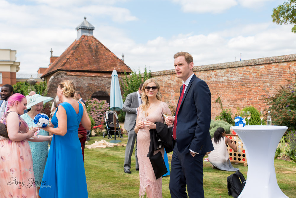 Walled garden drinks reception - documentary wedding photography Amy James photography