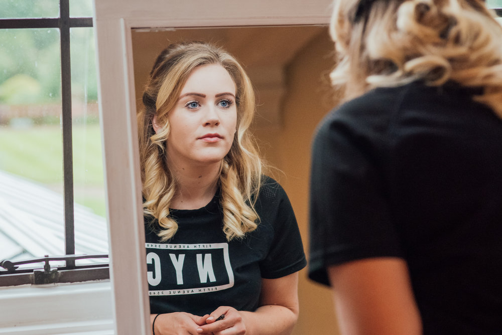 Bridesmaid getting ready at The Elvetham Wedding venue by Amy James photography Wedding Photographer Hampshire
