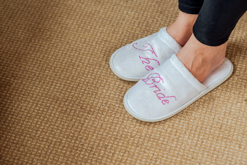 Bride slippers at The Elvetham Wedding venue by Amy James Photography - Wedding photographer Hampshire