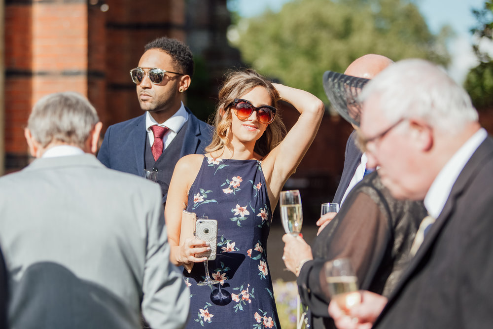 Candid photographs of wedding guests - Documentary wedding photographer Hampshire wedding photgrapher