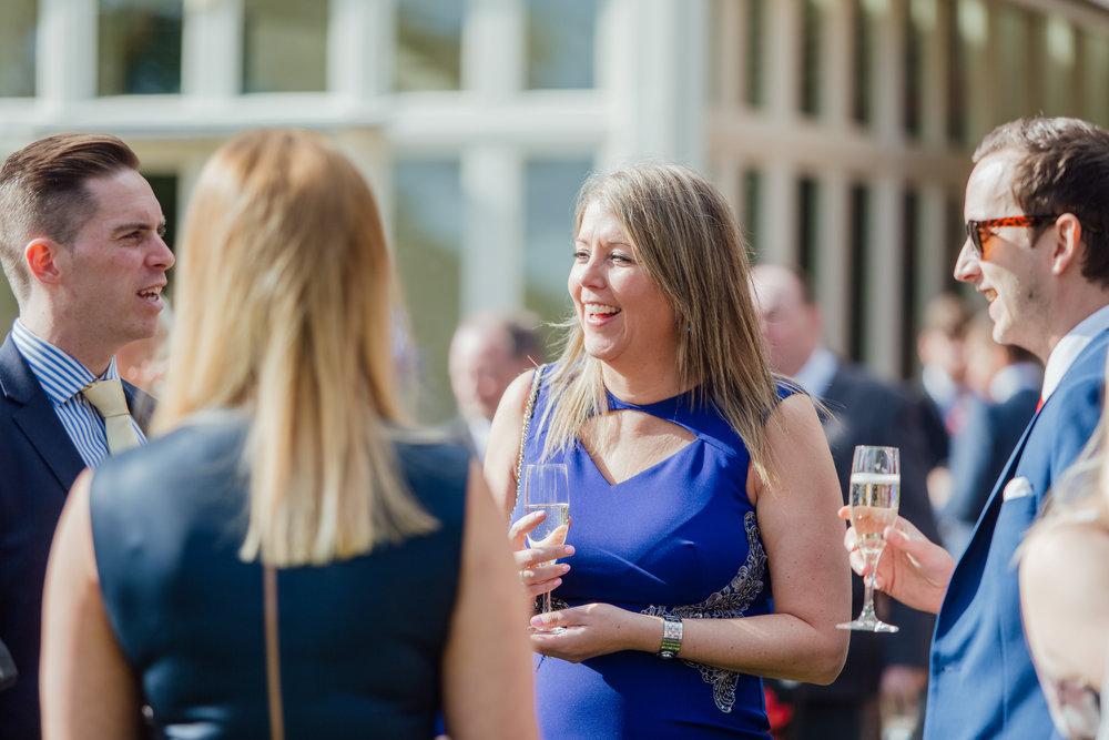 Candid photo of wedding guests by documentary wedding phohotgrapher - Amy James Photography - Wedding Photographer Hampshire