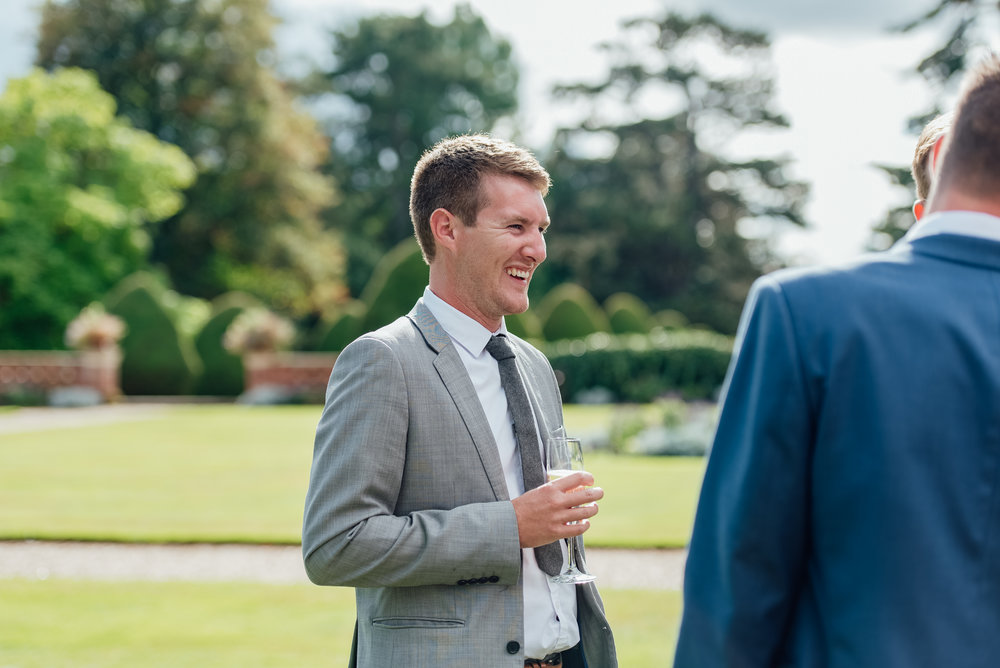 Amy James photography - Fleet Hampshire Wedding photographer - Candid photographs fo guests at a wedding