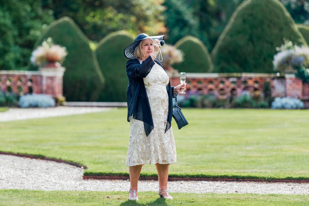 Guests at a wedding - documentary wedding photographer - Amy James photography - Fleet Hampshire wedding photographer
