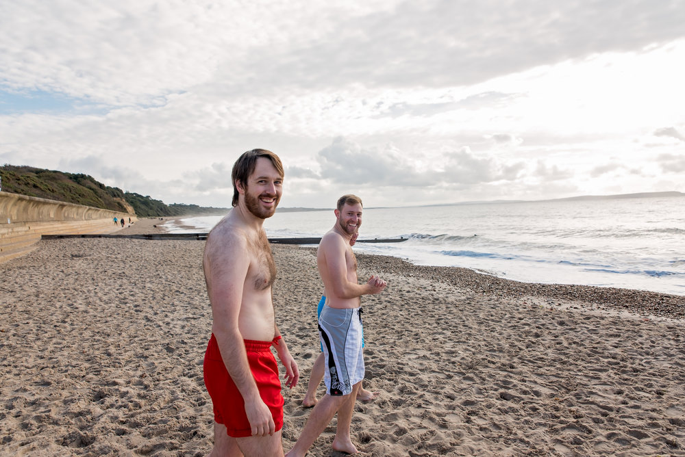Sea swimming at Friars Cliff Dorset - Amy James Photography - Documentary wedding photographer Hampshire