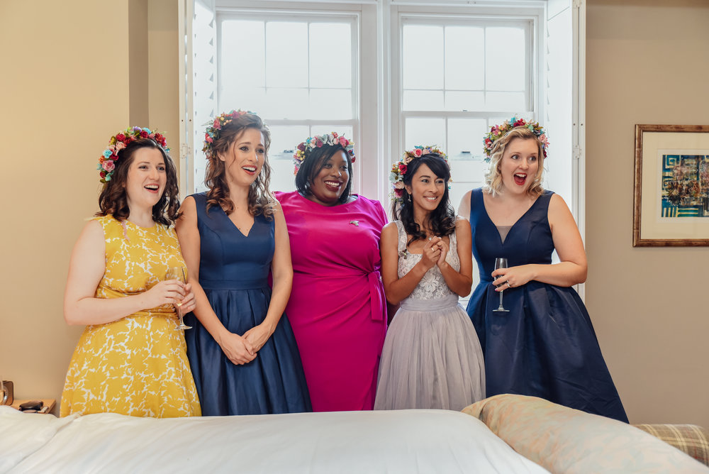 Bridesmaids seeing bride for the first time in her dress - by Amy James Photography - Wedding photographer Hampshire  Dorset and Surrey