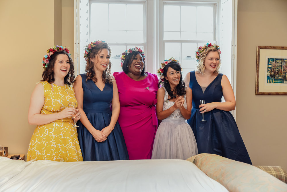 bridesmaids seeing bride in her dress for the first time - Amy James Photography - Documentary wedding photographer for Hampshire Dorset and Surrey