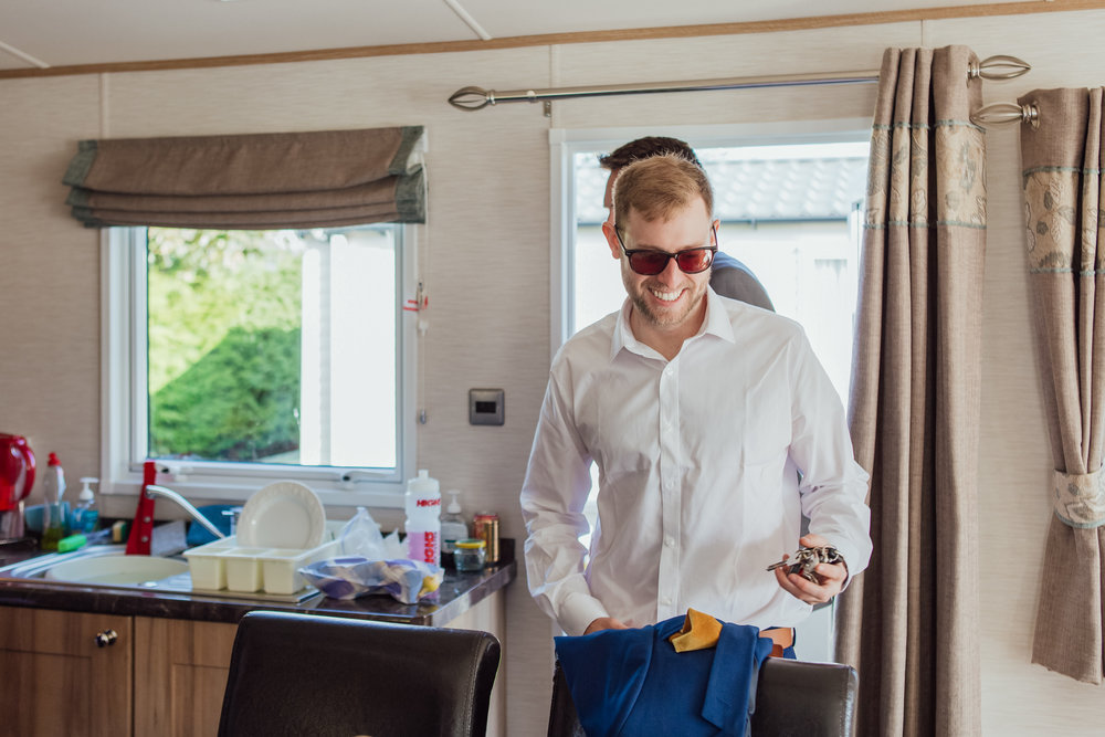 Groom preparations for highcliffe castle wedding