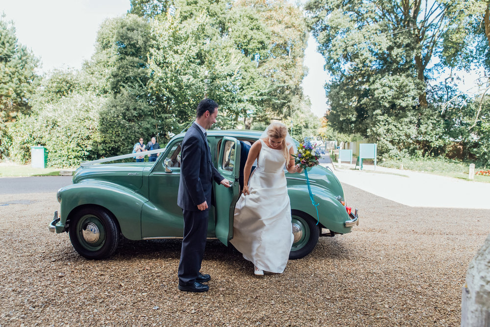 Bride arriving in vintage wedding car to Highcliffe Castle in Dorset - Amy James Photography - Wedding photographer for Hampshire Surrey and Dorset