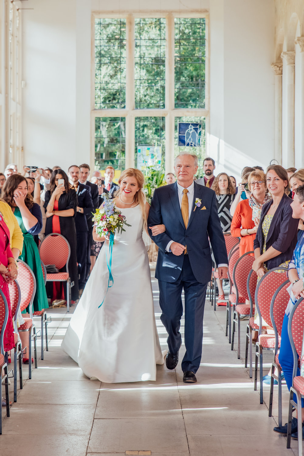 Bride and her father walking down the aisle at Highcliffe Castle Dorset - Amy James Photography - documentary wedding photographer for Hampshire Dorset and Surrey