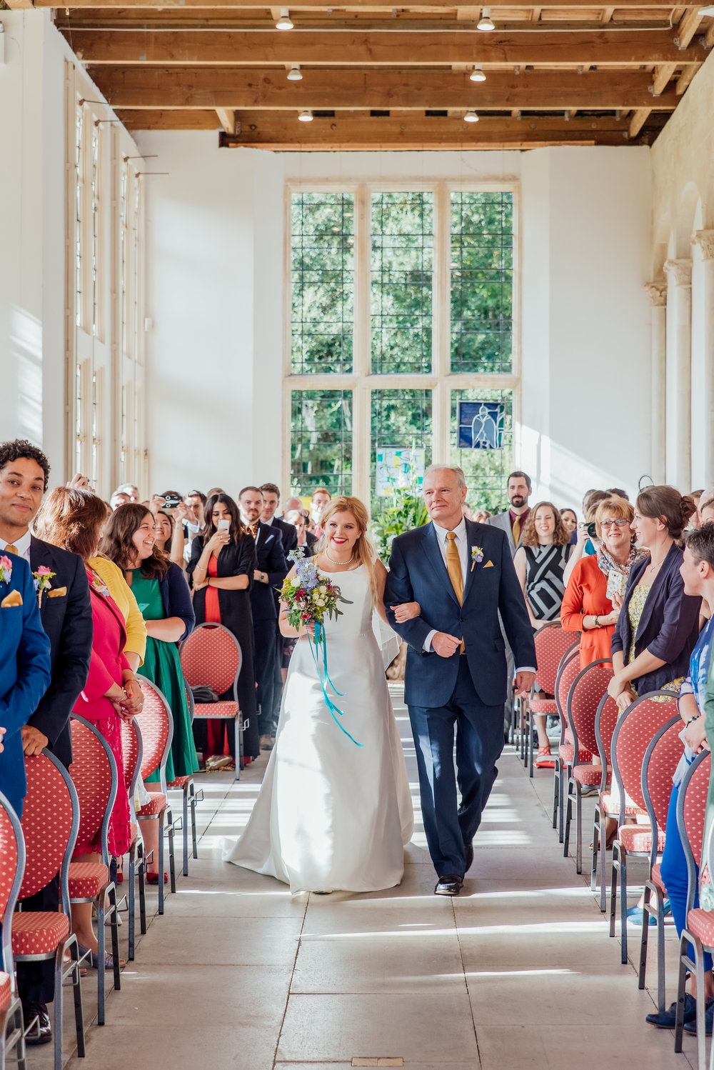 Bride and her Dad walking down the aisle at Highcliffe Castle Dorset - Amy James Photography - Documentary wedding photographer for Hampshire Dorset and Surrey