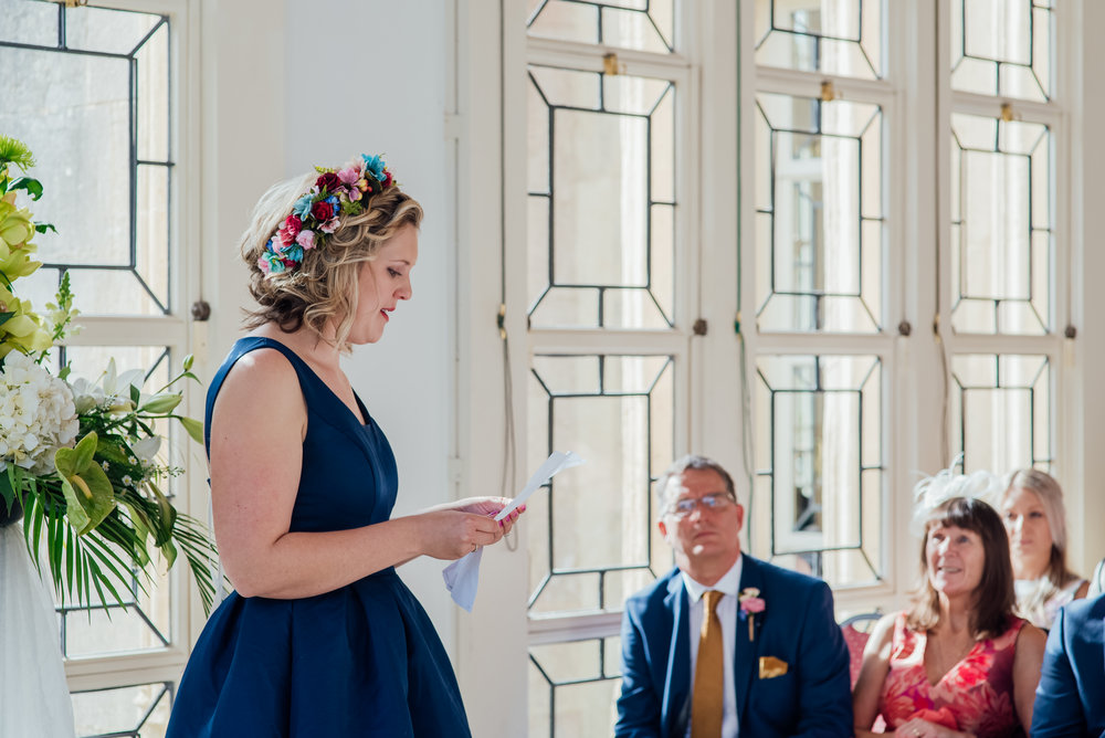 Bridesmaid givning a reading at highcliffe Castle Wedding in Dorset - Amy James photography - Hampshire wedding photographer