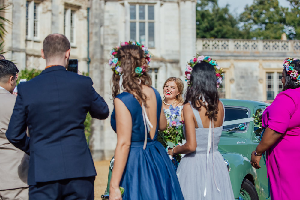 Bride laughing at Highcliffe Castle Wedding