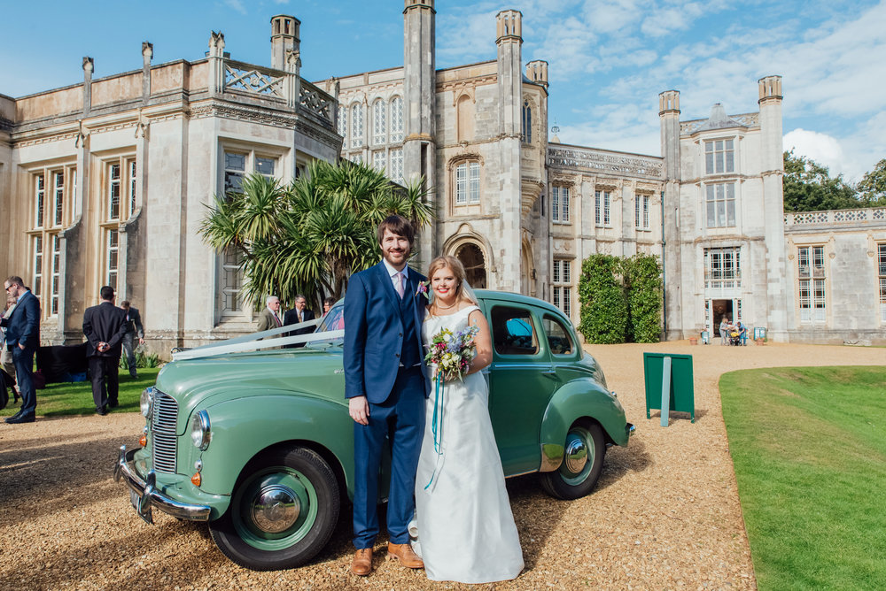 Bride and Groom with Vintage car at Highcliffe castle wedding in Dorset - Amy James Photography