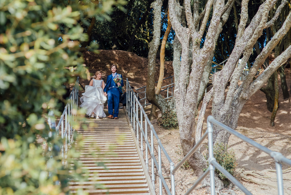 Bride and Groom walking down steps to the beach - Highcliffe Castle wedding - Highcliffe Beach Dorset