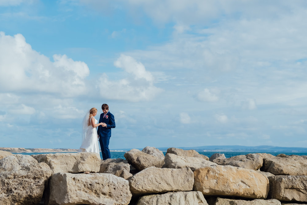 Bride and Groom on Highcliffe Beach - Highcliffe Castle Wedding - Dorset wedding - Hampshire wedding photographer - Documentary wedding photo