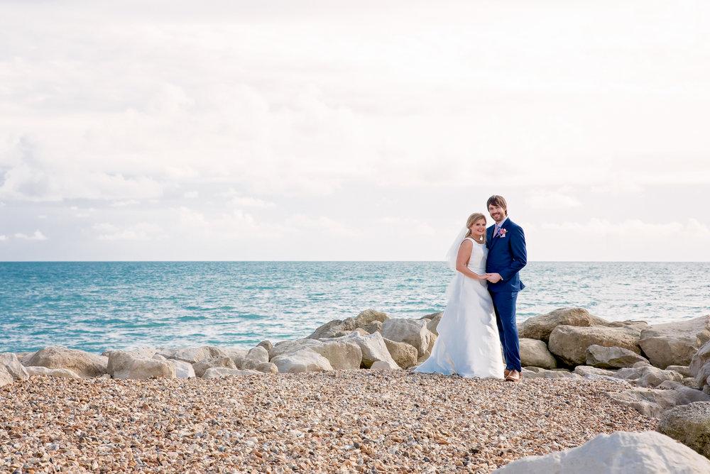 Bride and Groom on Highcliffe Beach - Beach wedding - Highcliffe Castle wedding - New Forest wedding - Amy James Photography - Beach wedding