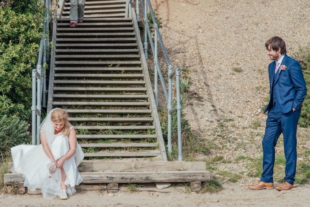 Bride and groom on Highcliffe Beach - Highcliffe Castle Wedding - Beach wedding - Documentary wedding photographer - Dorset wedding photographer - Hampshire wedding photographer - Amy James Photography
