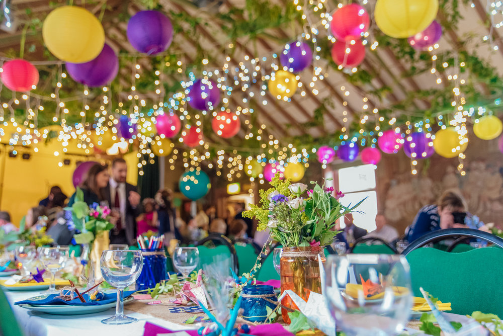 Handmade wedding decorations in a village hall wedding - colourful paper lanterns - fairy lights - New Forest Village Hall Wedding - Amy James Photography