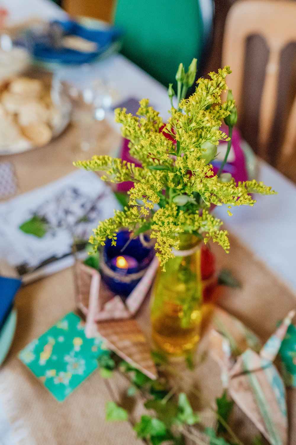 Colourful Wedding decorations at New Forest Village Hall Wedding by Amy James Photography - Hampshire Surrey and Dorset wedding photographer