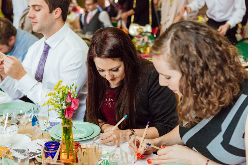 Guests at a colourful DIY wedding at a New Forest Village Hall - Amy James Photography