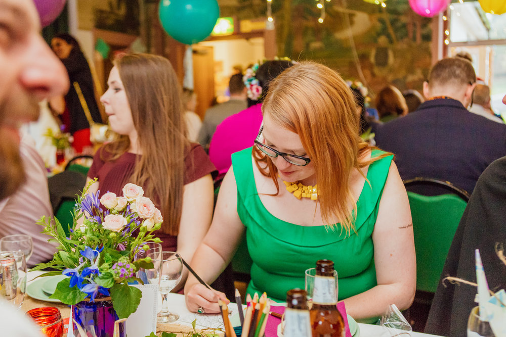 Colourful DIY wedding decorations at a New Forest Village Wedding