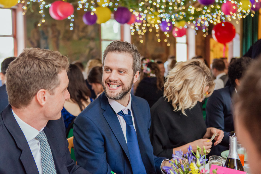 Colourful wedding decorations at New Forest Village Hall Wedding - Amy James Photography