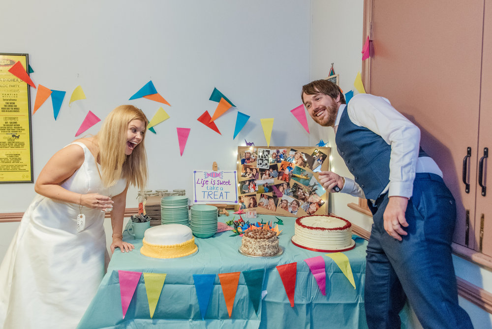 Cake table at colourful Wedding in the New Forest - Colourful DIY wedding decorations