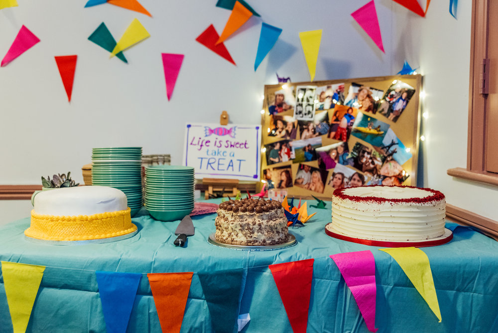 Colourful cake table at Village Hall Wedding in the New Forest - Amy James photography