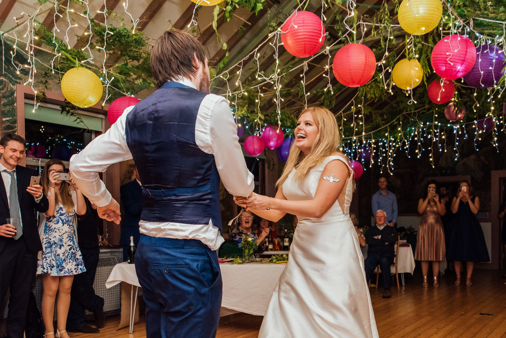 bride and groom first dance - colourful new forest village hall wedding